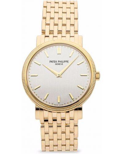 Желтые часы серебристые Patek Philippe