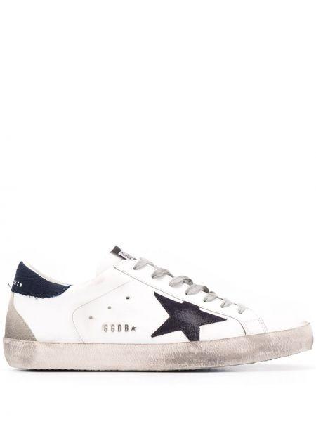 Ażurowy skórzany czarny sneakersy z łatami Golden Goose