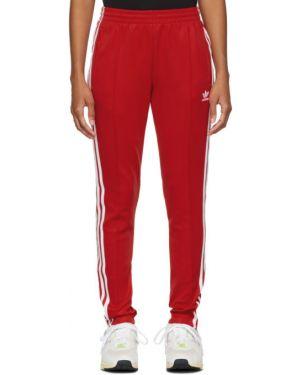 Спортивные брюки со штрипками с карманами Adidas Originals