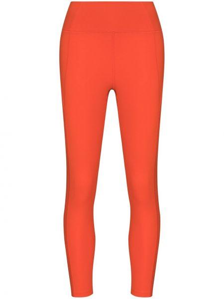 Pomarańczowe legginsy z wysokim stanem Girlfriend Collective