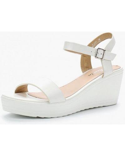 Белые босоножки на каблуке Renda
