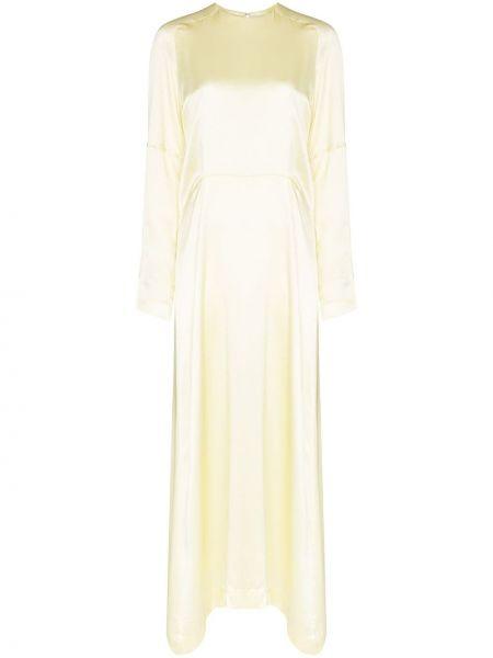 Расклешенное приталенное платье с оборками с драпировкой Carcel