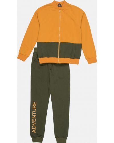 Костюмный оранжевый спортивный костюм свободного кроя Robinzone