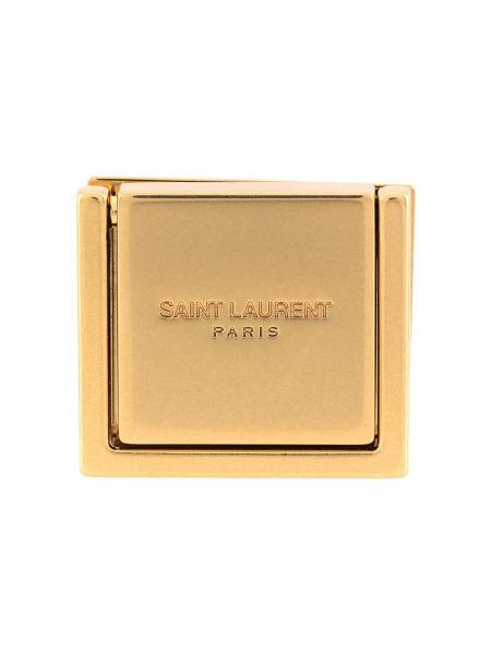 Золотистая брошь золотая с тиснением Saint Laurent