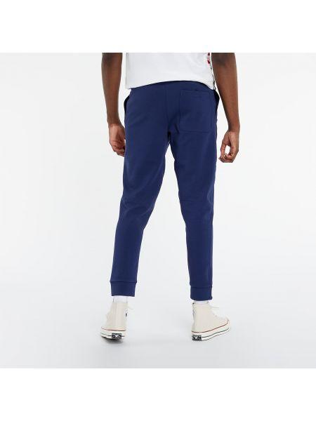 Niebieskie joggery srebrne Nike