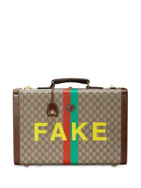 Beżowa walizka skórzana z printem Gucci