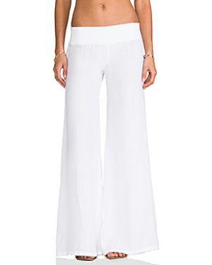 Белые льняные брюки на резинке с открытым носком свободного кроя Enza Costa