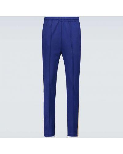 Niebieskie joggery skorzane w paski Gucci