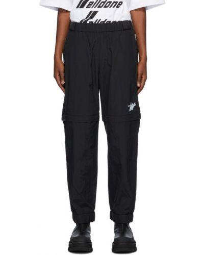 Белые спортивные брюки с поясом с манжетами с заплатками We11done