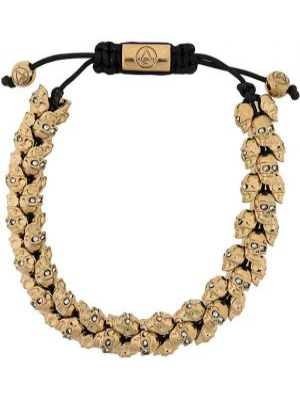 Золотистый браслет с черепами золотой с завязками Northskull