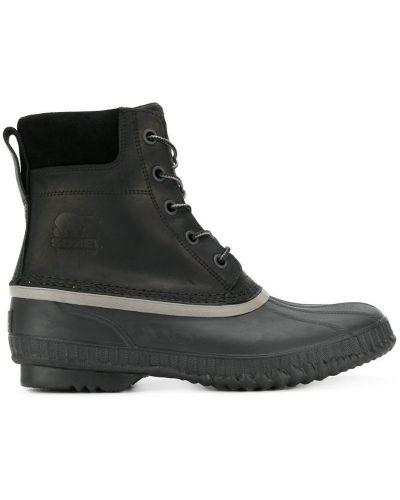 Ботинки на шнуровке кожаные на каблуке Sorel