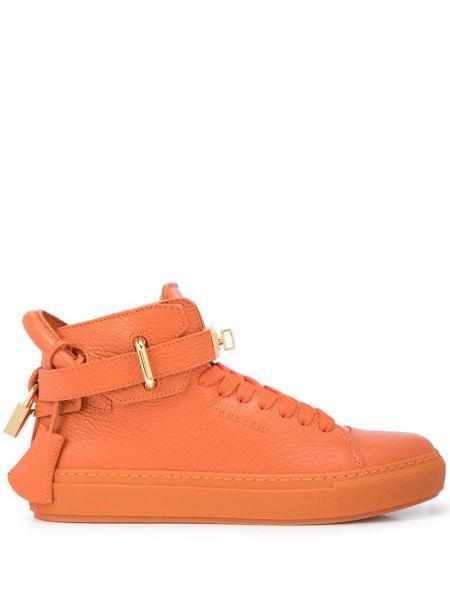 Pomarańczowe złote sneakersy Buscemi