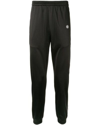 Черные зауженные брюки с поясом с манжетами бязевые Astrid Andersen
