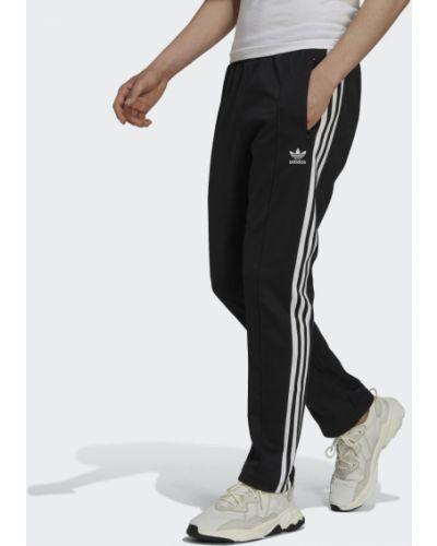 Черные спортивные брюки в полоску Adidas