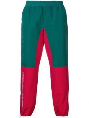 Нейлоновые спортивные зауженные брюки с поясом узкого кроя Johnundercover