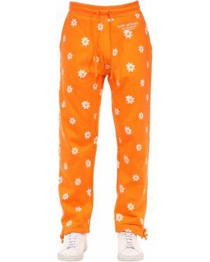 Pomarańczowe prążkowane joggery bawełniane Carrots