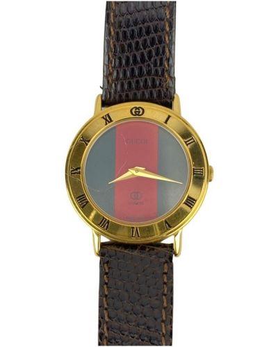 Żółty złoty zegarek na skórzanym pasku Gucci Vintage