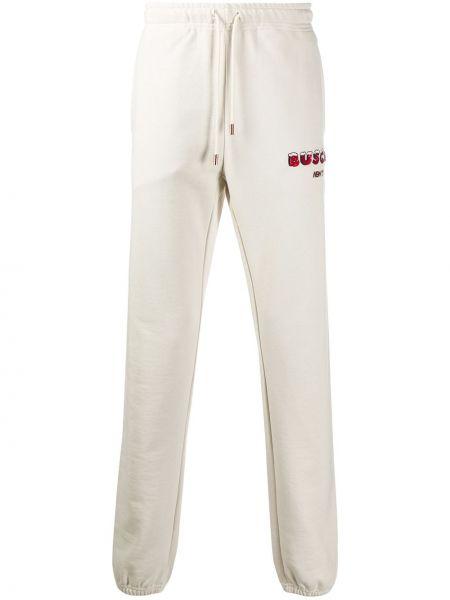 Białe spodnie bawełniane z haftem Buscemi