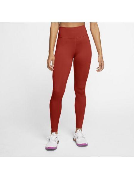 Pomarańczowe legginsy bezszwowe na co dzień Nike