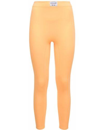 Pomarańczowe legginsy Adam Selman Sport