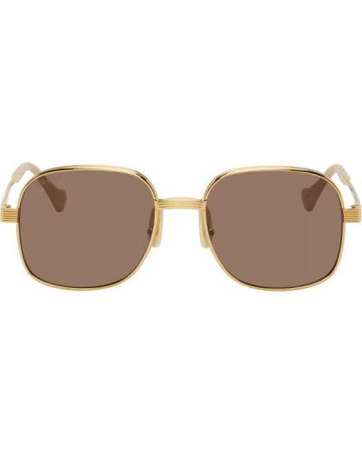 Złote różowe okulary Gucci