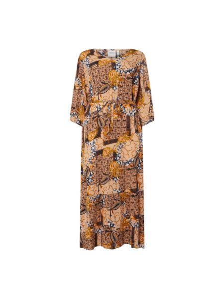 Złota sukienka rozkloszowana z dekoltem w serek Junarose
