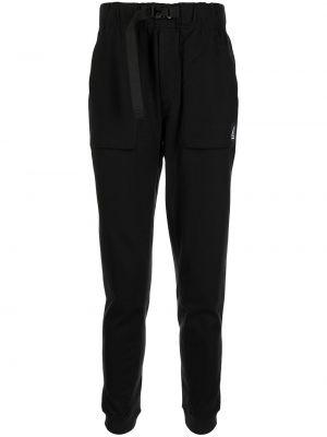 Черные зауженные брюки New Balance