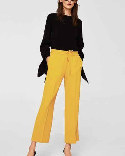 Свободные брюки с карманами с поясом Mango
