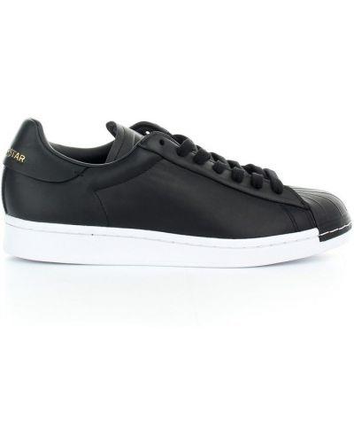 Złote czarne trampki Adidas