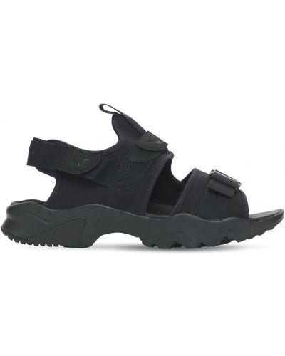 С ремешком сандалии Nike