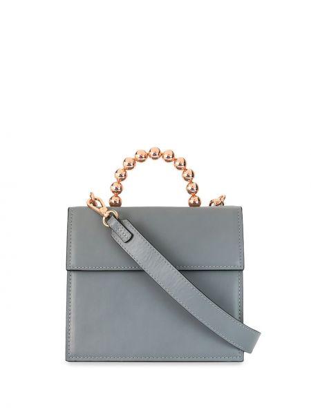 Серая кожаная сумка круглая металлическая с декоративной отделкой 0711