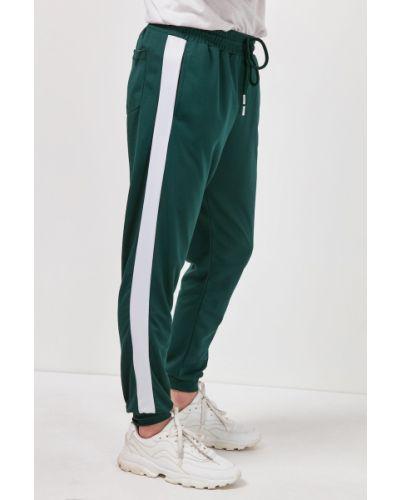 Spodnie dresowe w paski - zielone Trendyol