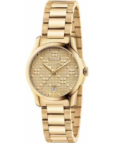Золотистые часы водонепроницаемые золотые Gucci