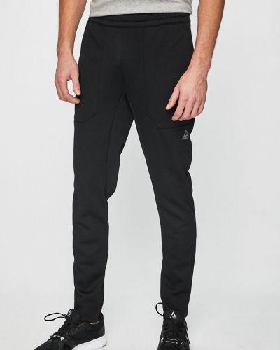 Spodnie długo z kieszeniami Reebok