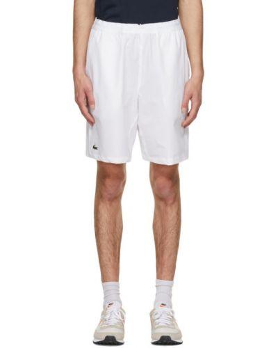 Теннисные белые спортивные шорты с карманами Lacoste
