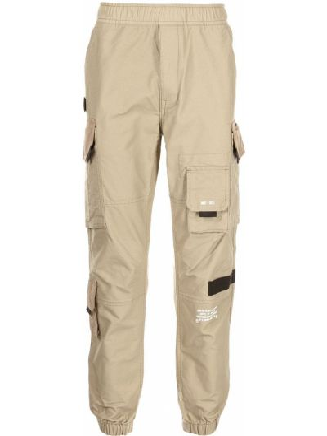 Beżowe spodnie z printem Aape By A Bathing Ape