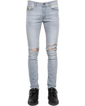 Niebieskie jeansy April 77