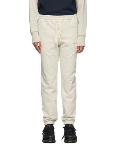 Beżowe spodnie z haftem Aime Leon Dore