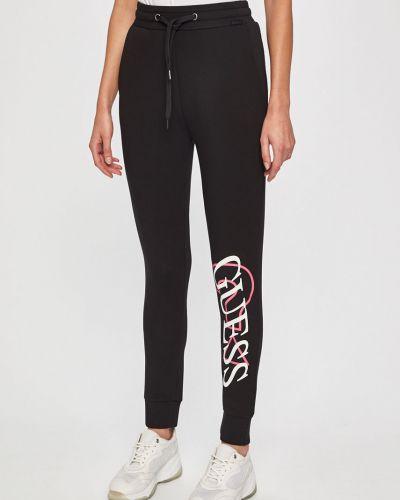 Брюки на резинке с карманами свободные Guess Jeans