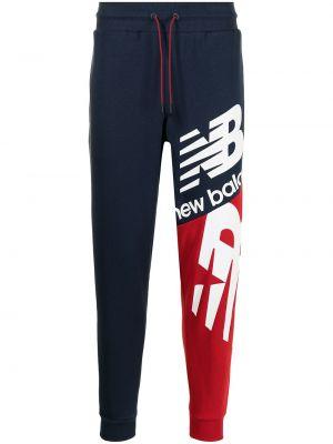 Синие спортивные брюки New Balance