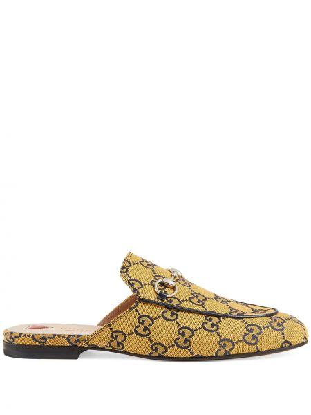 Żółte kapcie skorzane na obcasie Gucci