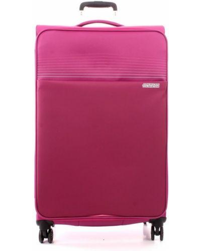 Różowa walizka oversize American Tourister