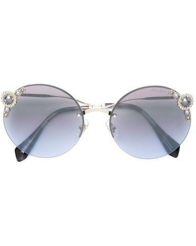 Солнцезащитные очки металлические круглые Miu Miu Eyewear