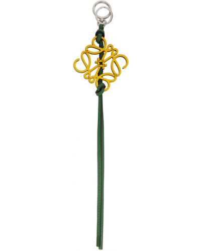 С ремешком желтый брелок с тиснением Loewe