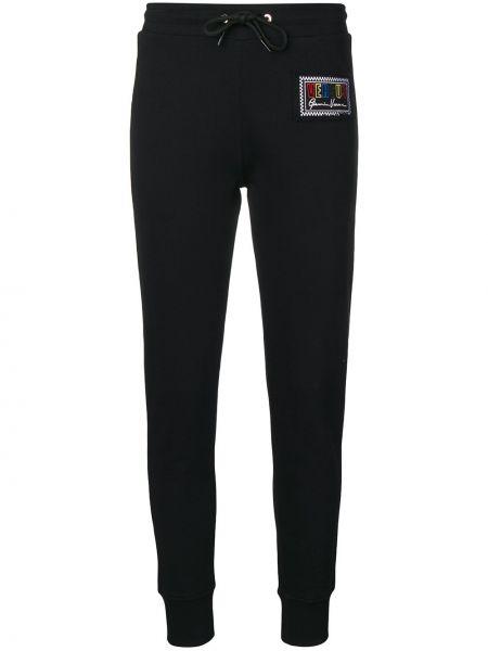 Хлопковые черные брюки с вышивкой с карманами Versus