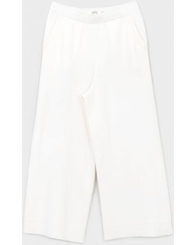 Белые брюки Unq