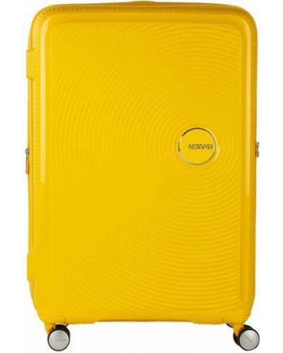 Żółty walizka na gumce z zamkiem błyskawicznym amerykański American Tourister