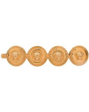 Желтая брошь металлическая Versace