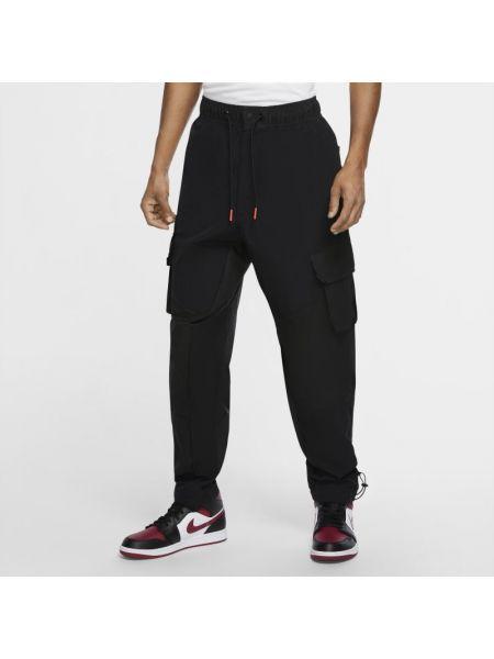 Włókienniczy spodni bojówki z mankietami prążkowany Nike