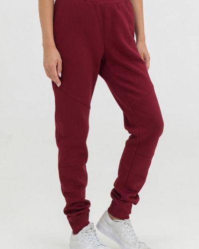 Красные спортивные брюки The Cave